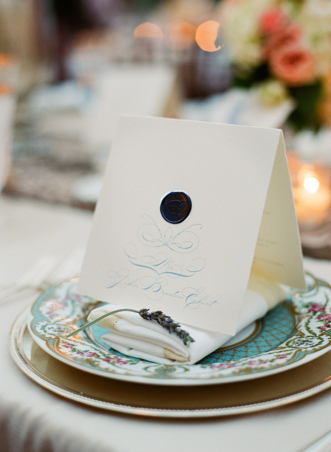 Vintage place setting, menu card with blue calligraphy and dark blue monogram wax seal. Paper goods by Tucked, image by Jen Fariello.