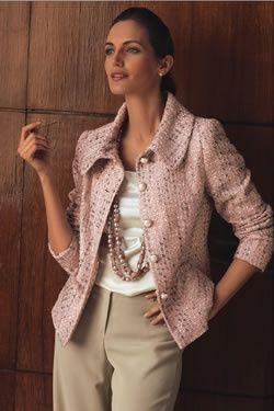 Pink jacket, beads and khakis