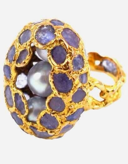ARTISTIC PEARL AND SAPPHIRE RING, ca 1960's This is one of the most ususual rings that we have had. We don't know who made it, but he or she was a talented designer and craftsperson. Three beautiful grey pearls are nested in an oval of sapphire slices set in textured gold.