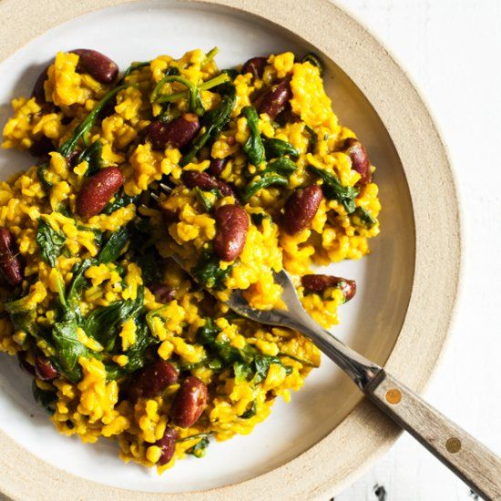 A simple, one pot meal of fragrant turmeric rice, beans, and greens. Healthy and easy to prepare!