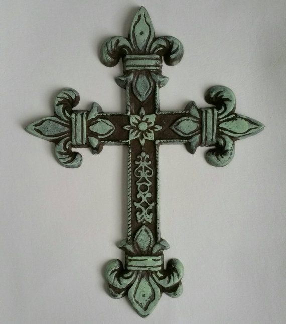 Check out this item in my Etsy shop https://www.etsy.com/listing/234366434/rustic-cross-mint-green-cross-cast-iron
