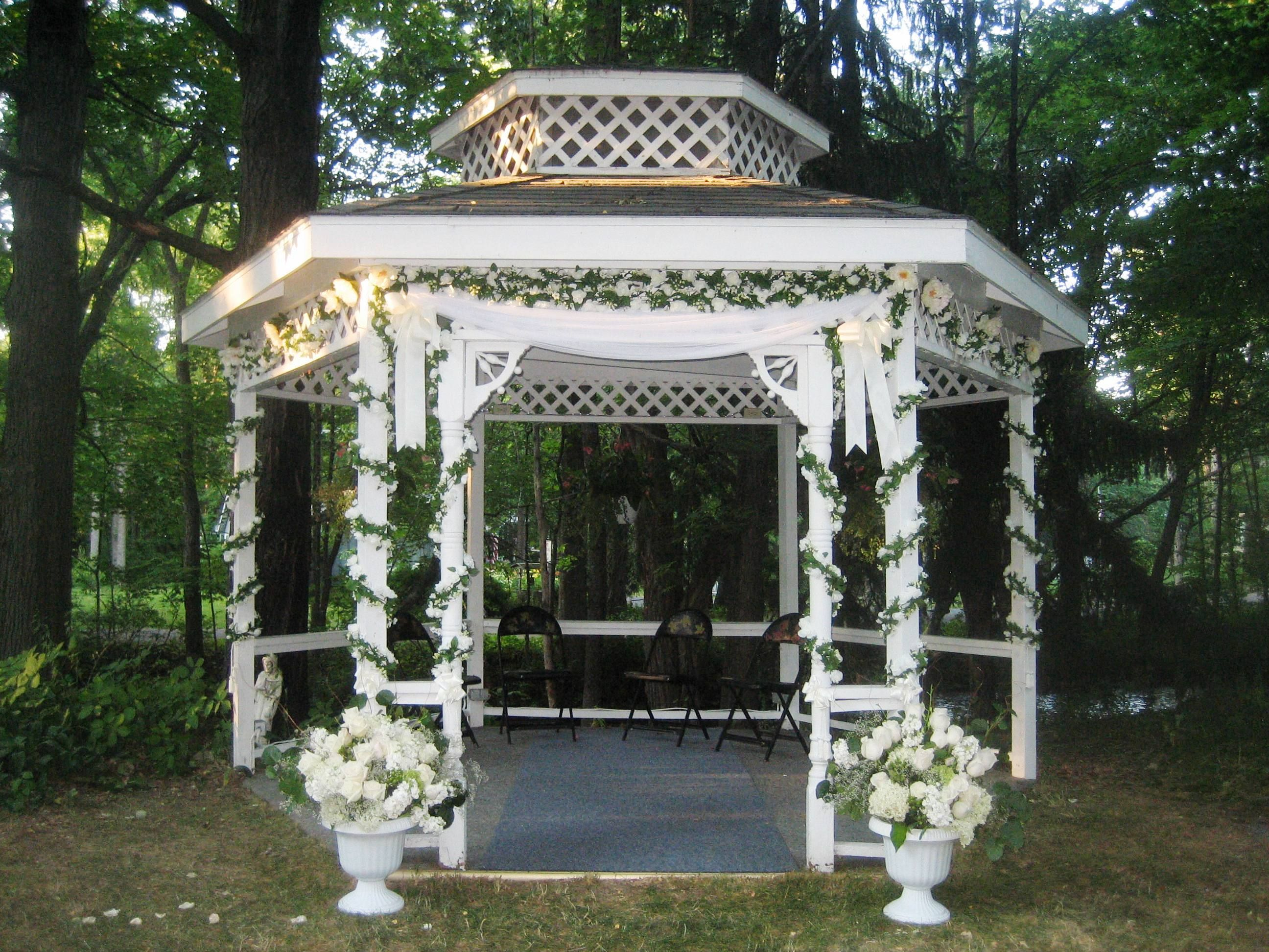 There was a flute quartet seated in the gazebo and wedding for Outdoor wedding gazebo decorating ideas