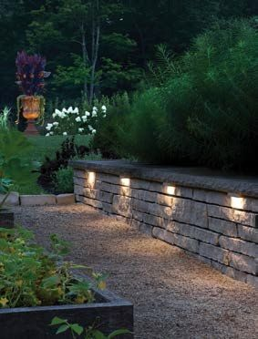 This retaining wall is accented with Hinkley's Hardscape