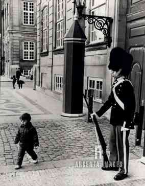 argentaimages:  A young Crown Prince Frederik of Denmark walks around the square at Amalienborg Castle