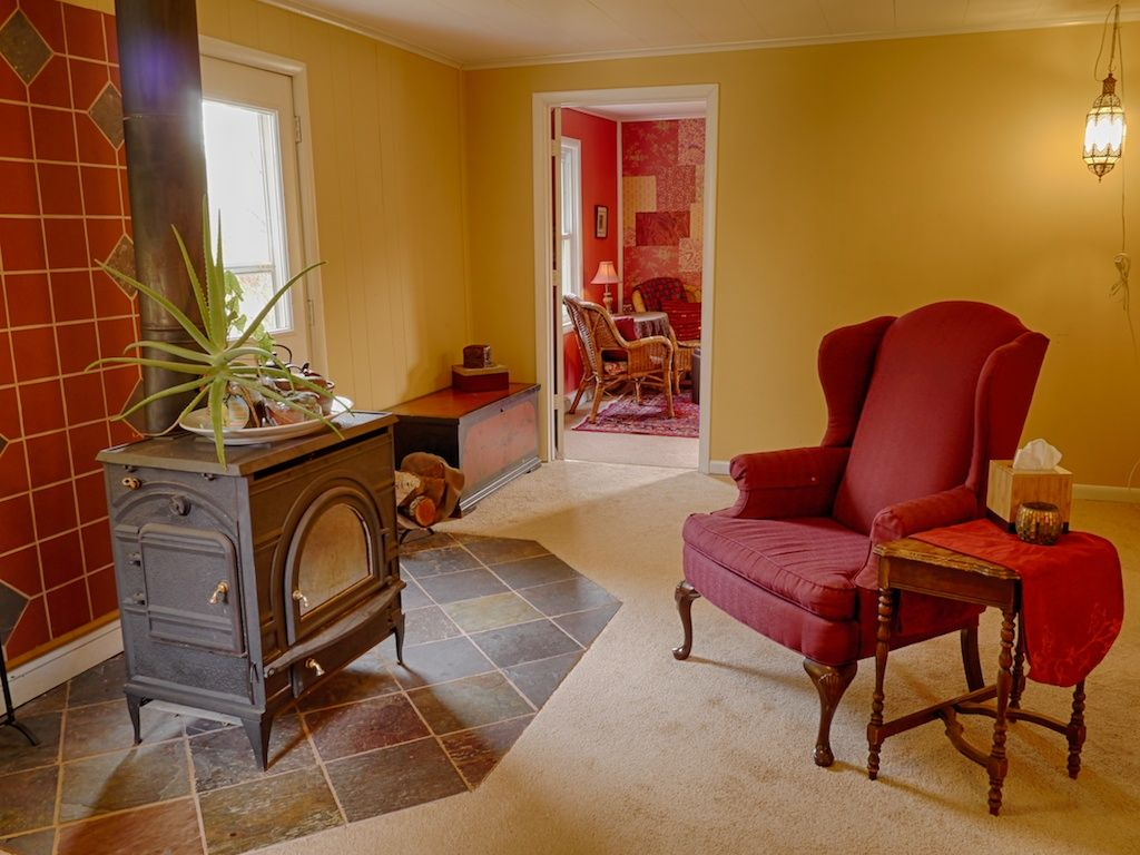 wood stove, slate and terracotta tile, and yellow walls in this