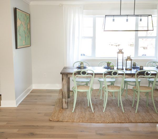 Eclectic dining room with a mix of farmhouse table and mint green bentwood chairs kellyelko.com