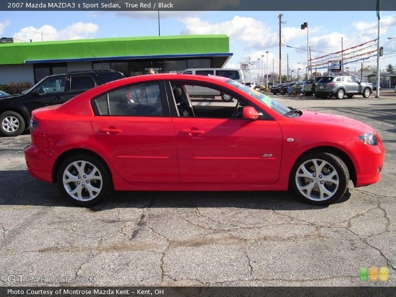 Looks just like my car, red with black interior. Mazda 3 5 speed, fun to drive, great on gas...also super-reliable.