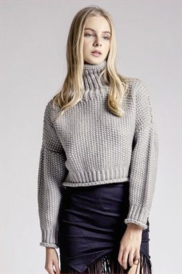 Stone Cold Sweater: This sweater features a turtle neck, slight cropped fit, and chunky knit. 100% acrylic. Model wears XS.