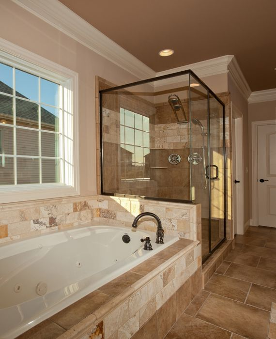 Love the tub and shower next to each other different tileing tho pots and pans and powder - Different showers ...