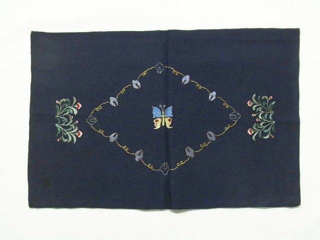 This is a table center with a design of butterfly in diamond and flower, which is embroidered.  It also has woven sayagata pattern on the right side, and 'genjiko' (ancient Japanese incense) pattern on the wrong side