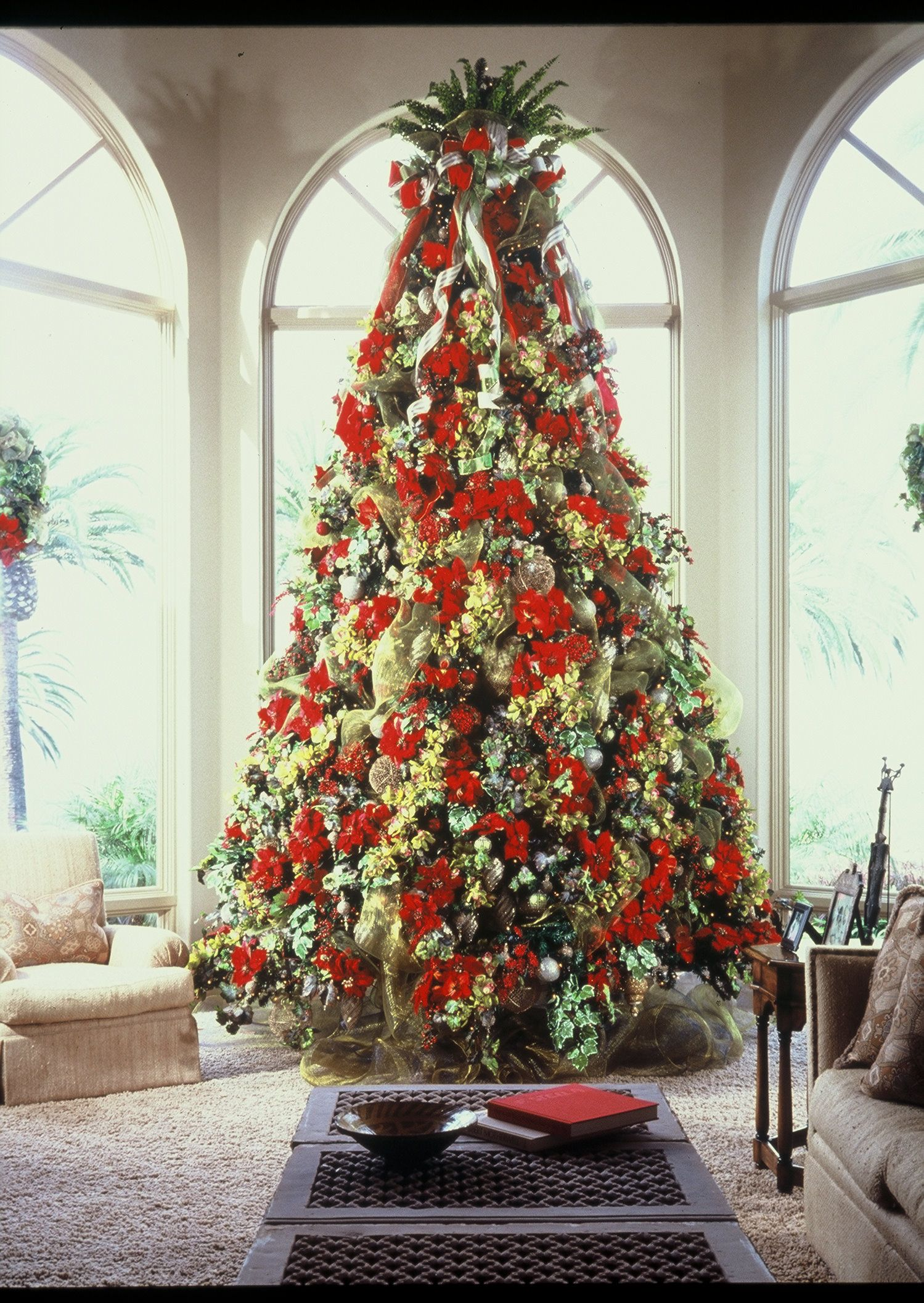 wwwleannemichaelcom 15ft tree dressed in red poinsettias green orchids and gold