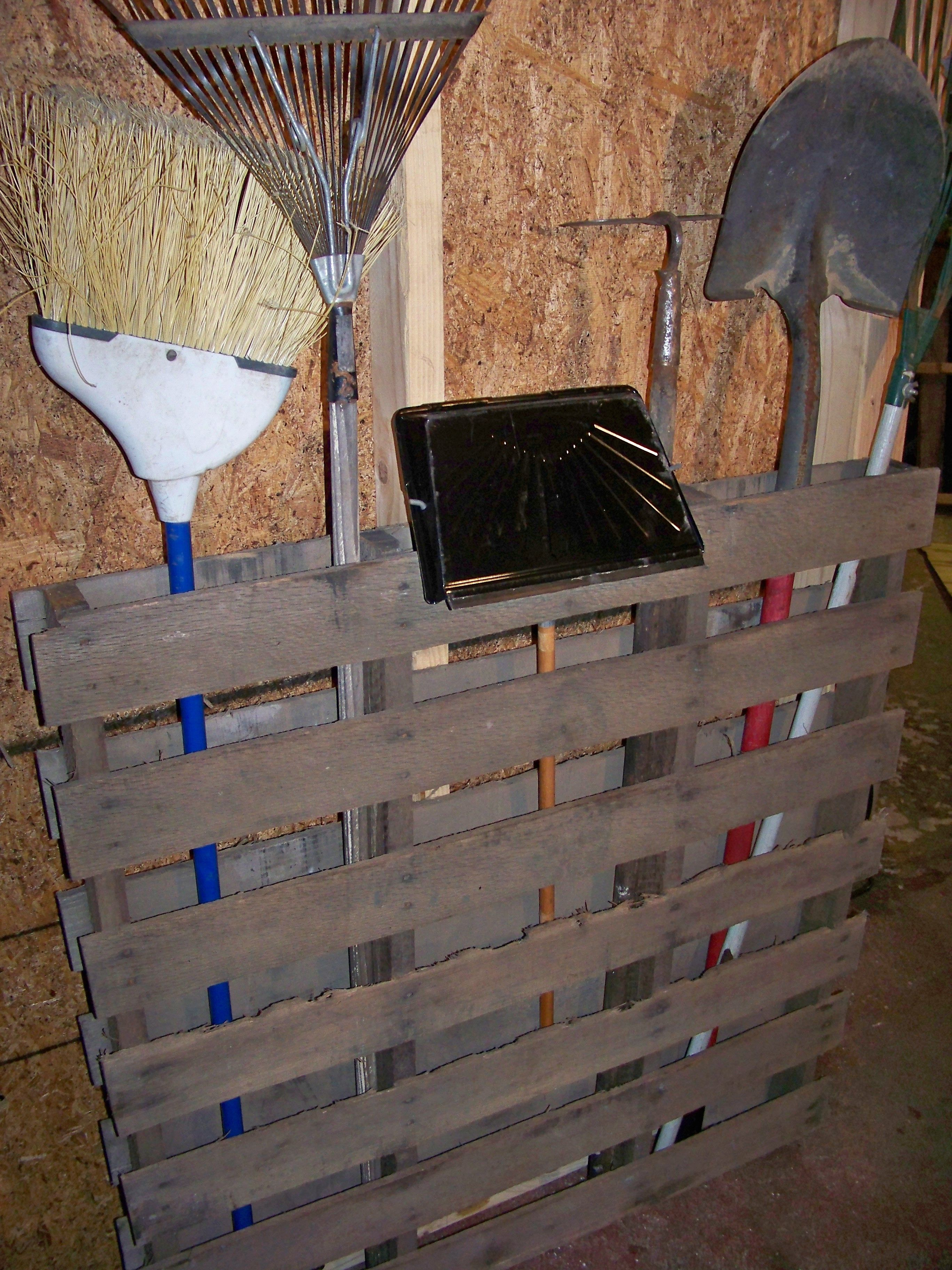 Use an old pallet for tool/cleaning storage in a barn or shed.  GREAT IDEA!!!!