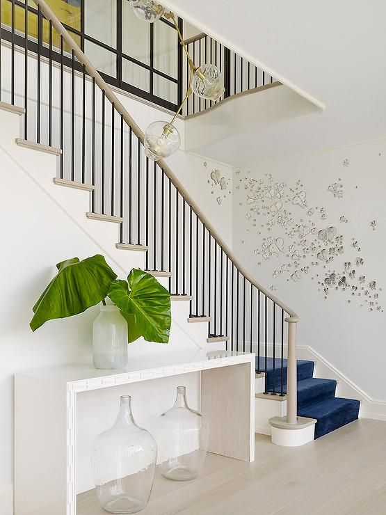 Perfect Eclectic Foyer Features A Light Taupe Staircase Lined With A Royal Blue  Velvet Stair Runner As Well As Butterfly Wall Art Alongside A Pair Of Wine  Jugs ...