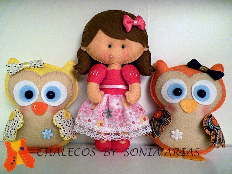 Doll accompanied by two owls, yellow and orange, all in felt