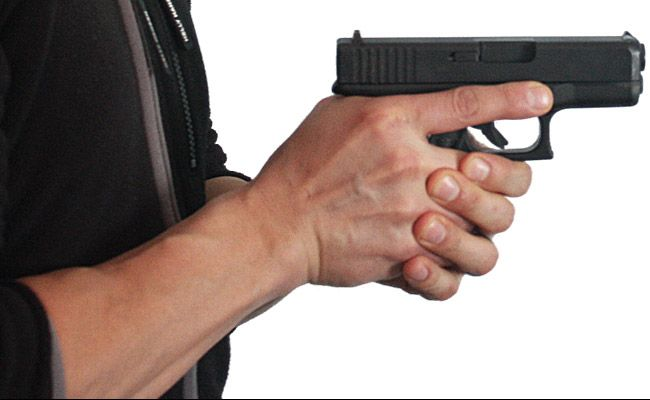 Guide To Life Hold And Shoot A Handgun Properly Hand Guns Guns Guns Pose