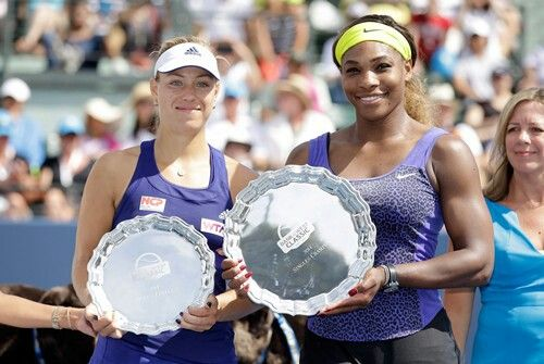 Angelique Kerber and Serena Williams pose with their trophies.