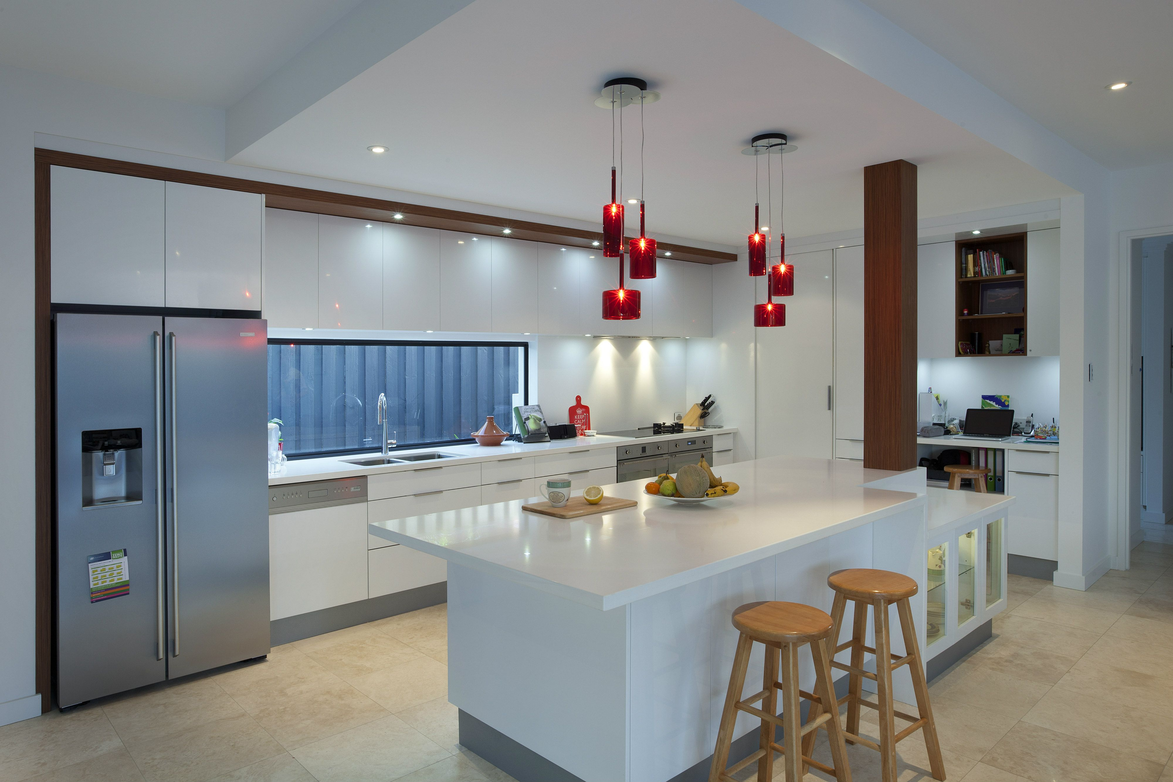 This cleverly designed kitchen hides the clutter behind a half wall ...