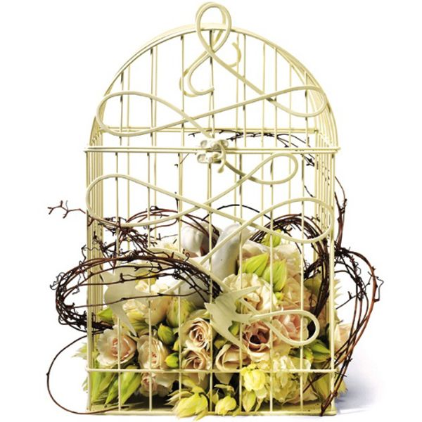 For a unique centerpiece, fill a birdcage with flowers