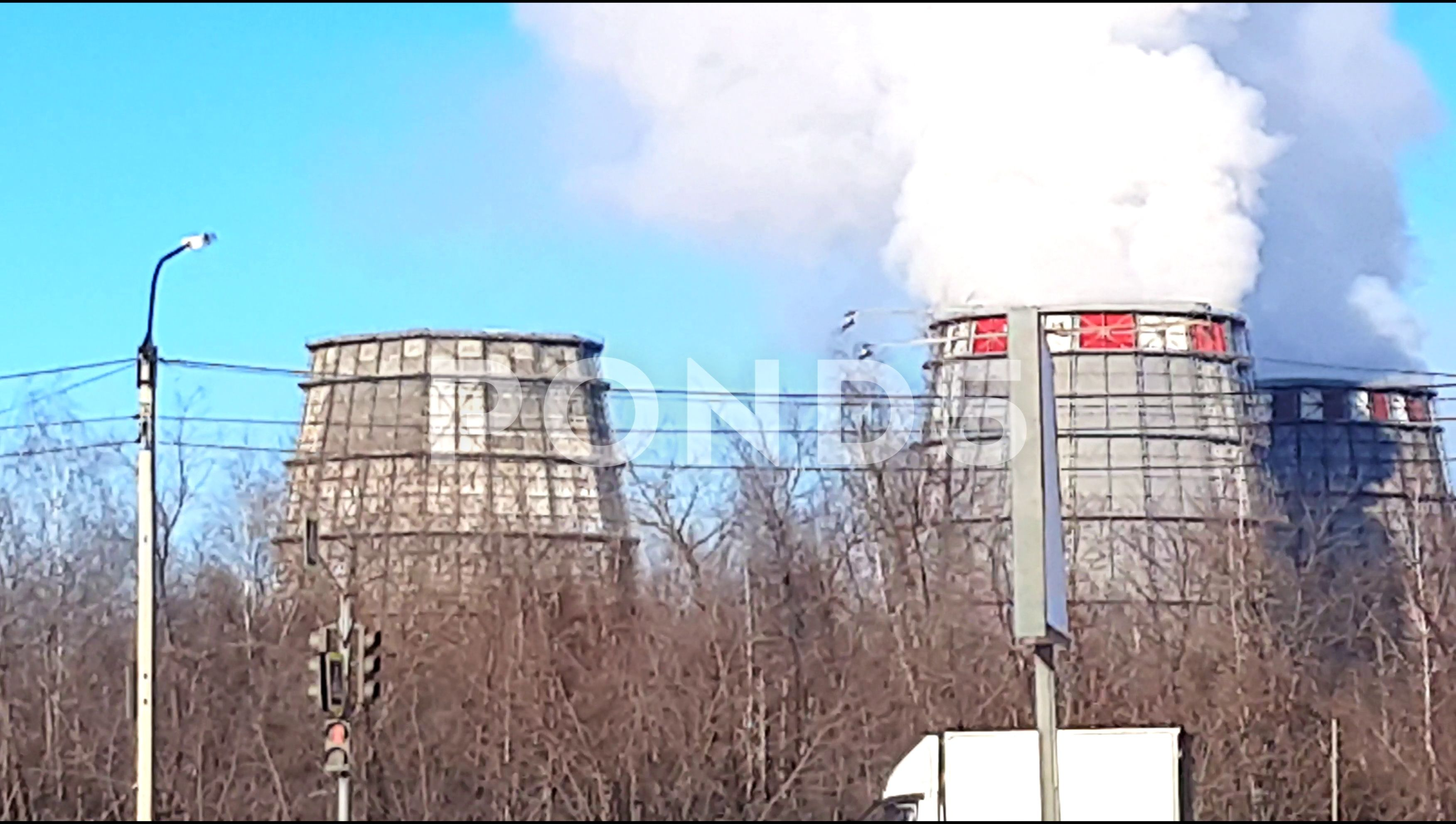 Industrial Zone With Large Pipes Cooling Towers With Puffs Of