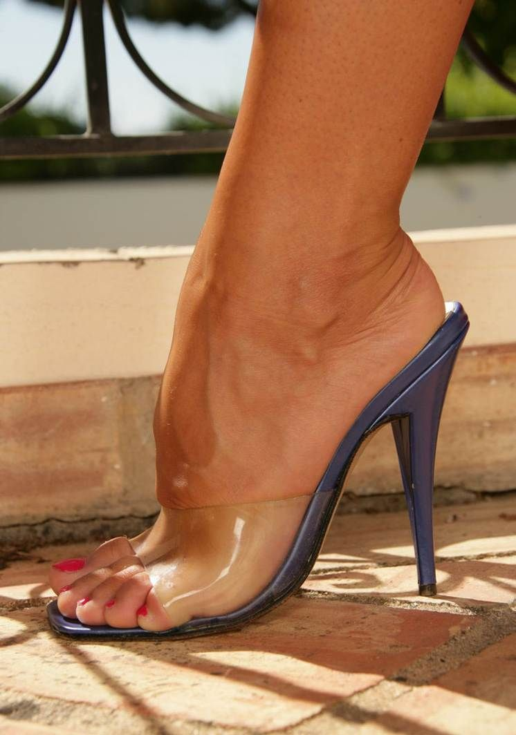 Gorgeous Tanned Foot Squeezed In A Clear Mule Heels