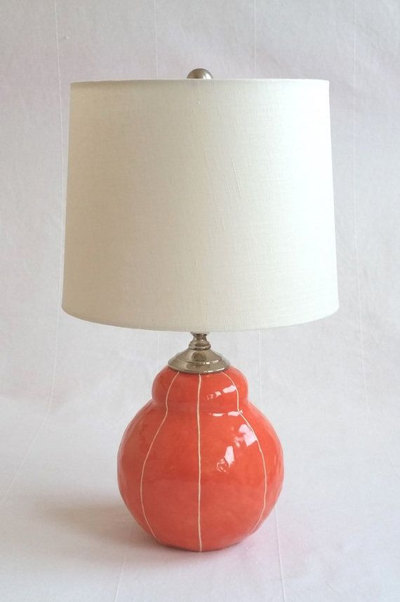 Short bedside table lamp round modern shape ceramic base coral red with thin white