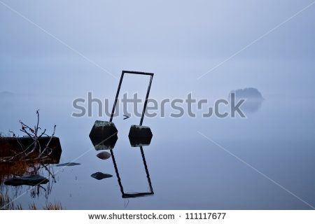 Vigorous mist over a lake. An island is visible through the fog.