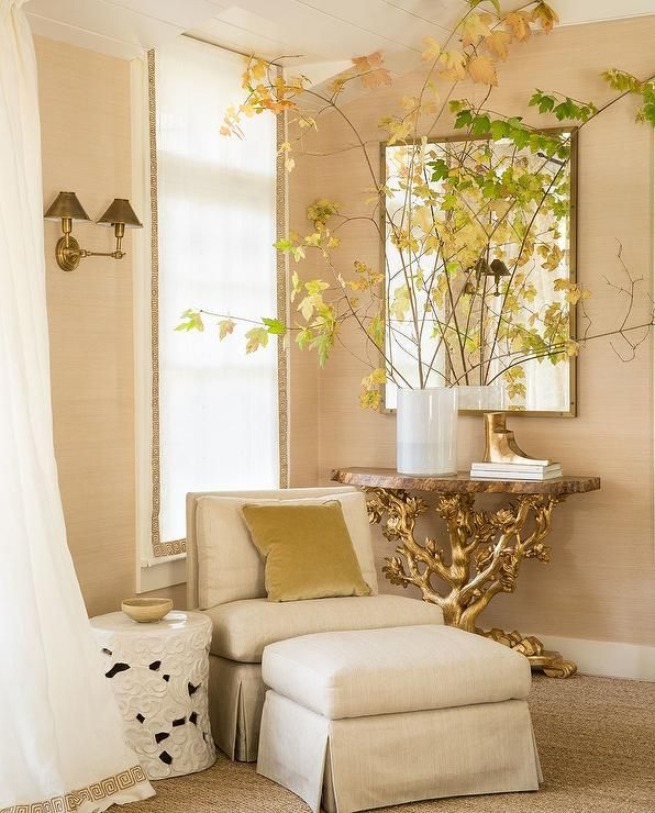 Gold bedroom reading corner is filled with a wood and gold faux bois ...