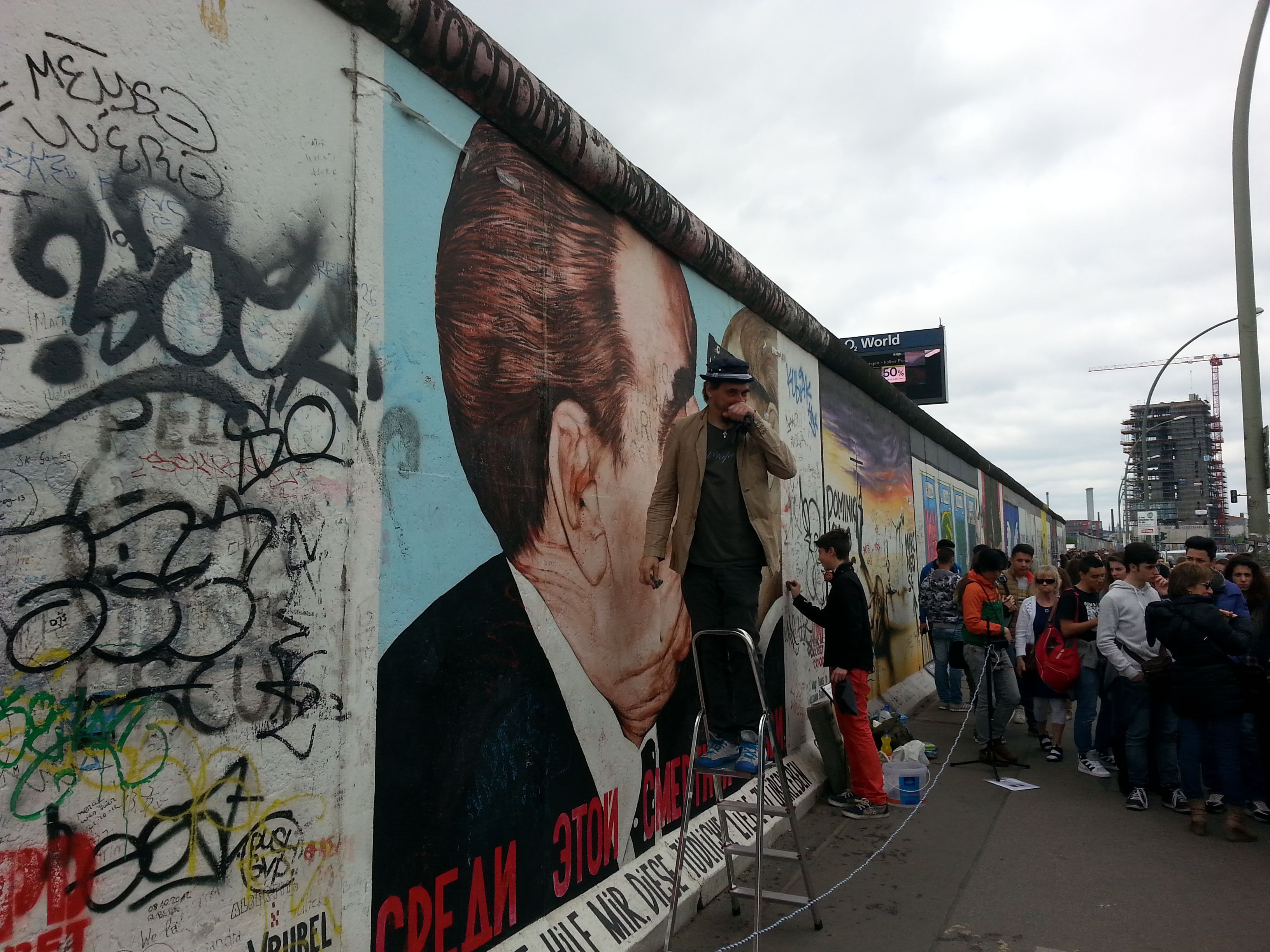Dmitry Vrubel And His Son Cleaning The Bruderkuss At Eastsidegallery The City Of Berlin Can T