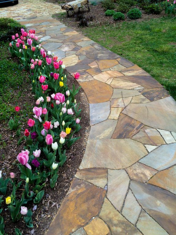 Flagstone pathway makes it hardscape Plants and grass make It ...