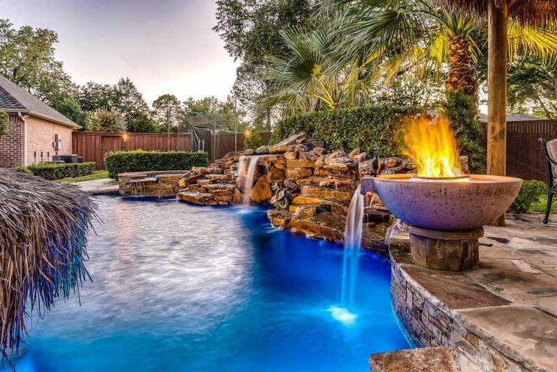 Dallas Pool Fire Water Features Photos Frisco Pools Fire Wok Pot Medium Waterfall And Moss Rock Grotto Backyard Pool Designs Pool Builders Pool