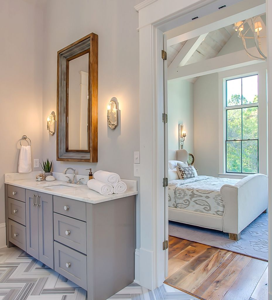 5 Surprising Ways Paint Color Can Enhance Your Home S Features Grey Bathrooms Dark Gray Vanity Grey Bathroom Cabinets Bathroom zircon sherwin williams