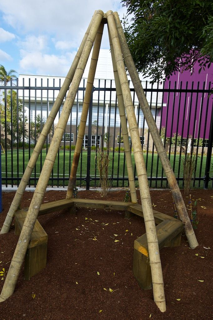 A large bamboo teepee seat is ringed with sensory