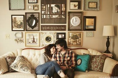 Lots of love and individuality here clocks mirrors and even collages of the couple all make - Wall collage ideas living room ...