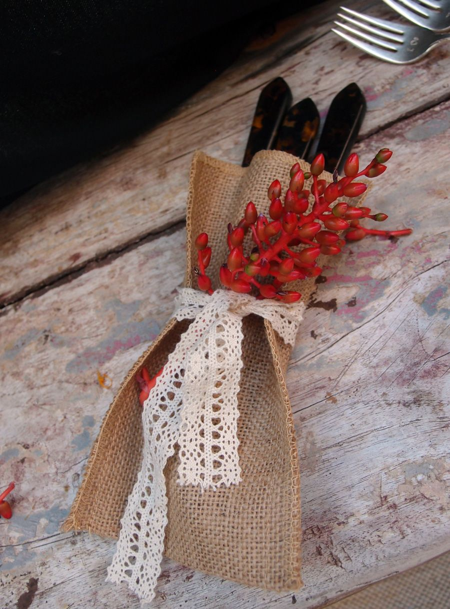 "Our burlap jute bag 4-1/2"" x 7-1/2"" with cotton embroidered ribbon used to hold silverware"
