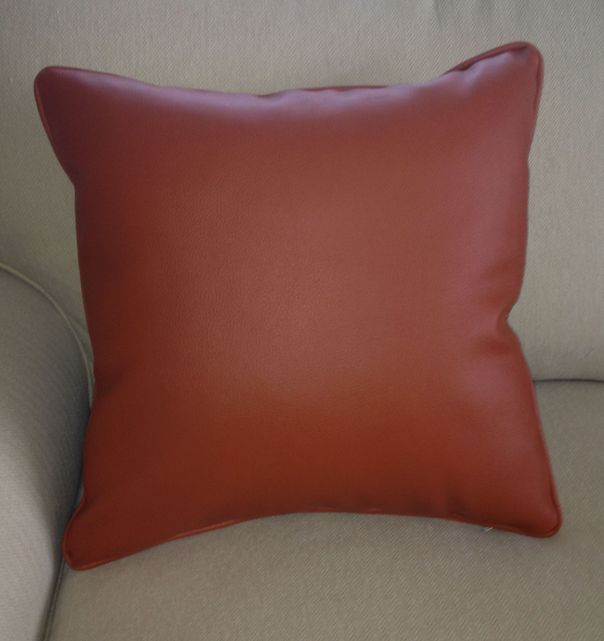 """orange recycled leather and polyurethane 18x18"""" pillow cover with hidden zipper and self welt.$45.00.www.kellydesignsofCT.com"""