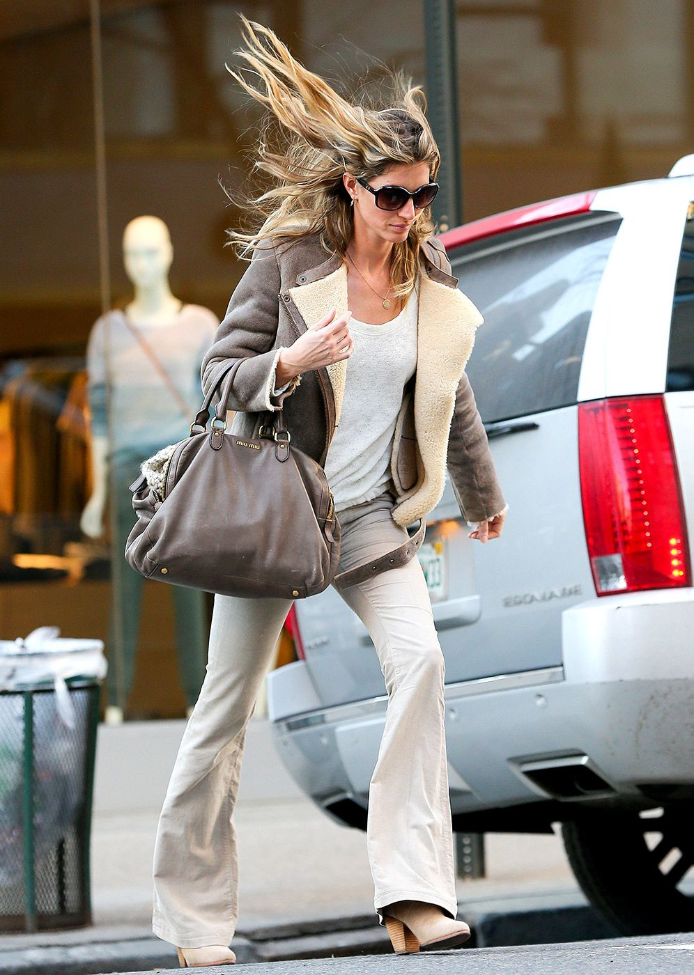 Gisele Bundchen's world-famous locks got whipped up in the chilly March winds as the supermodel mom crossed Madison Avenue during an NYC shopping trip March 11.
