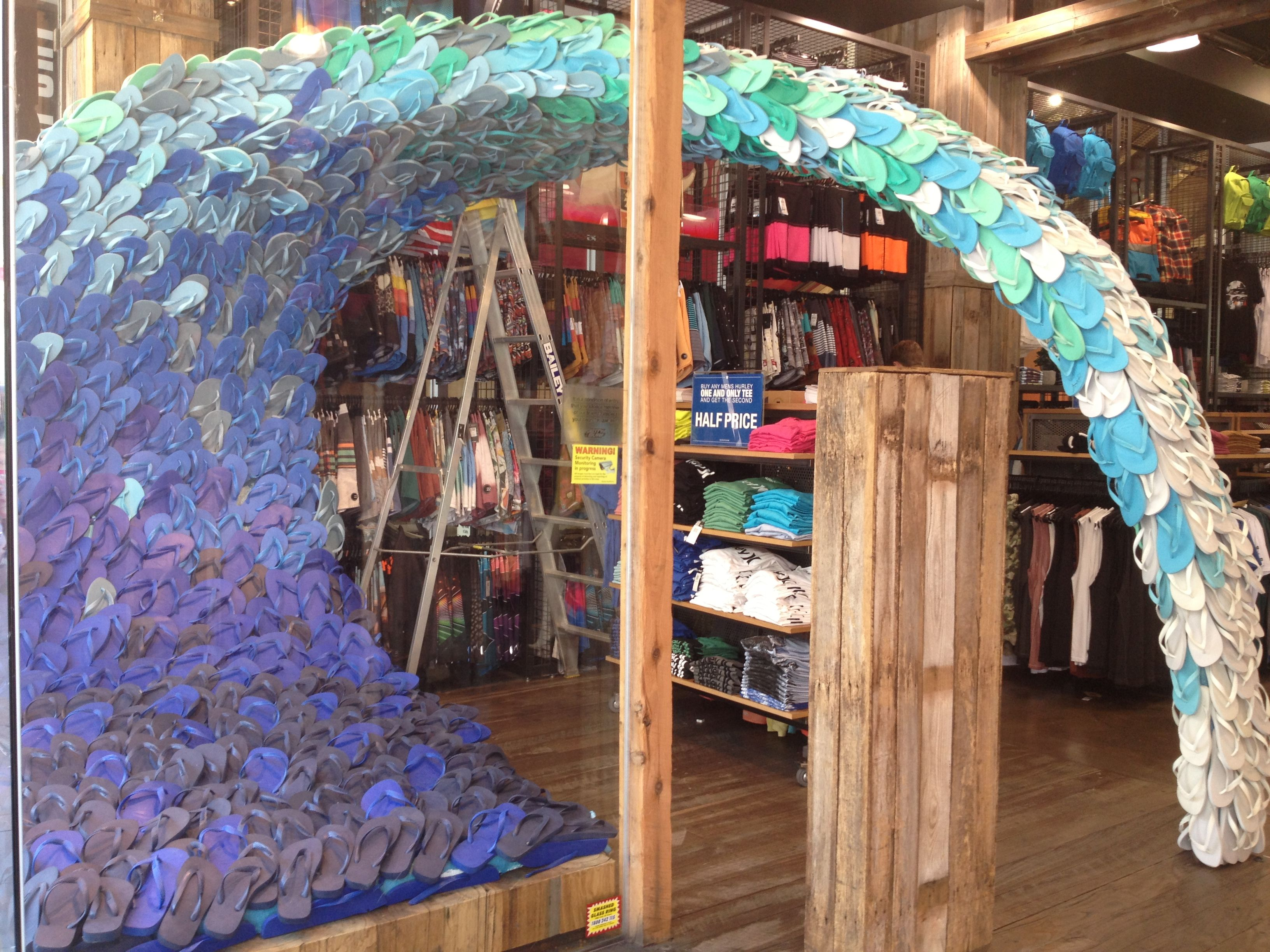 A 7 Foot Wave Made Of Thongs On Display At A Surf Shop In Melbourne Shop Window Design Holiday Window Display Surf Shop