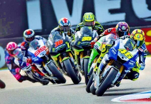 MotoGP riders following the racing line at the beginning of a race with the Doctor leading.