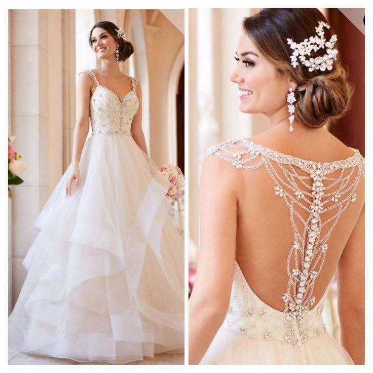 Gorgeous ball gown with textured bottom and amazing back detail. -