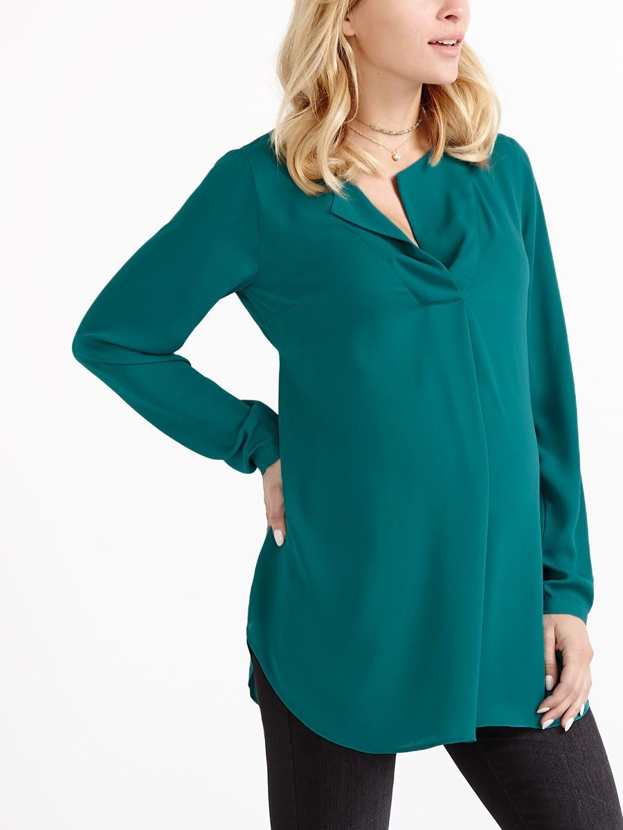 b1bff8be14609 Make it from Monday to Friday in style with this classic maternity blouse!  It features a split neck with flap collar, long sleeves and tie at back for  a ...