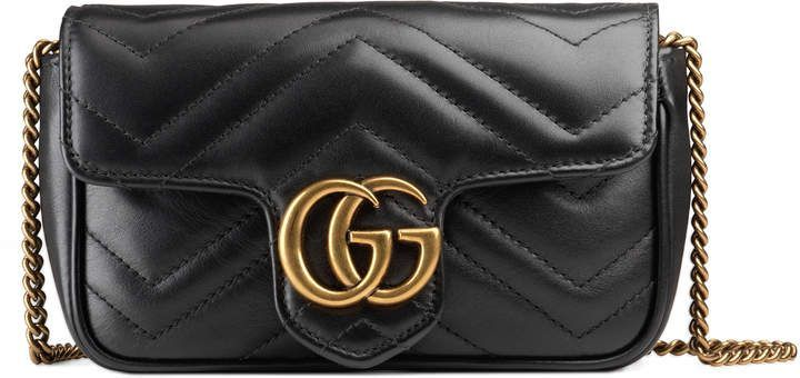 ad GG Marmont matelassé leather super mini bag. The GG Marmont mini bag  has a key ring that can be used to attach it to a separate larger bag. 17eed0d4bafb9