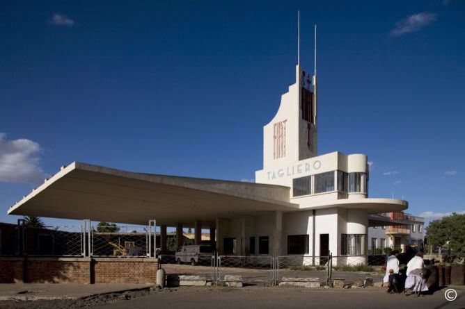 Fiat Tagliero building, an airplane-shaped Futurist Style petrol and service station, designed by Guiseppe Pettazzi, completed in 1938. It has 98ft (30 m) long concrete wings on each side.