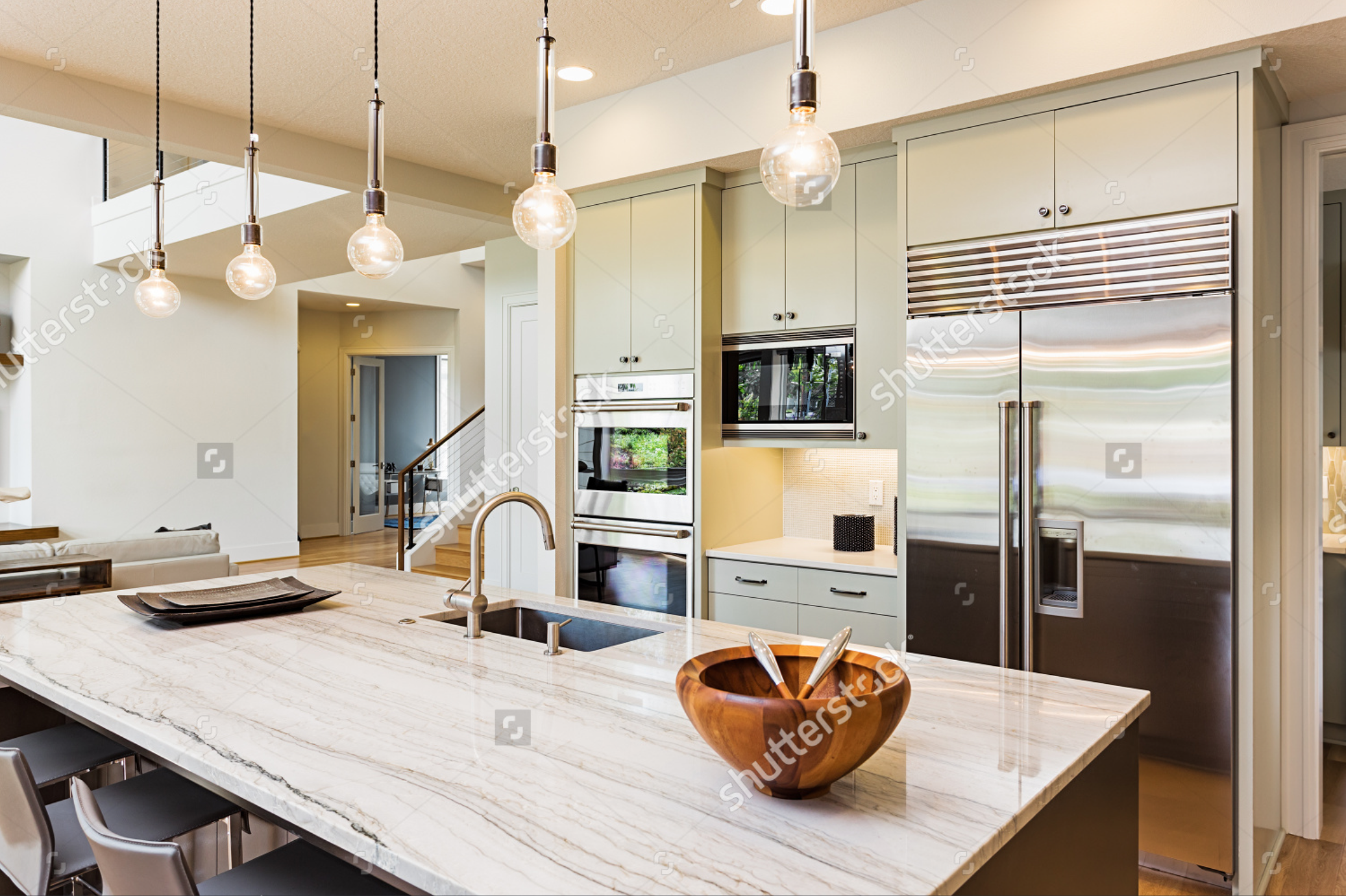 //  https://www.shutterstock.com/pic-318263891/stock-photo-kitchen-in-house-kitchen-interior-with-island-sink-cabinets-stainless-steel-refrigerator-pendant-lights-and-hardwood-floors-in-new-luxury-home.html?src=h_m8CrhBEadaWT1fSYw9Vg-1-13