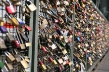As a way of showing their love for one another couples in Cologne Germany fix locks to the railings on the Hohenzollern Bridge. Love locks | www.cologne.de
