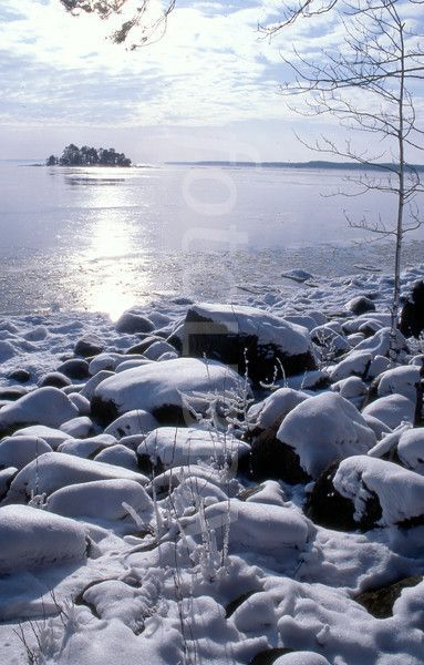snowy covered rocks by a lake in Sweden