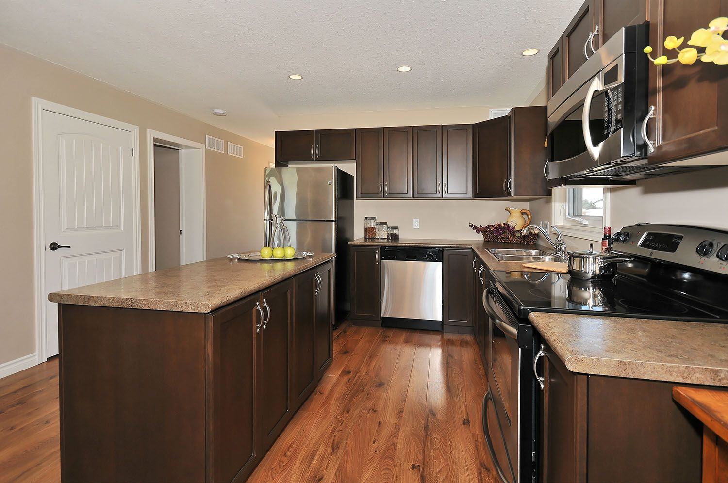dark laminate flooring in kitchen the haliburton barzotti cabinets maple swedish walnut 8564