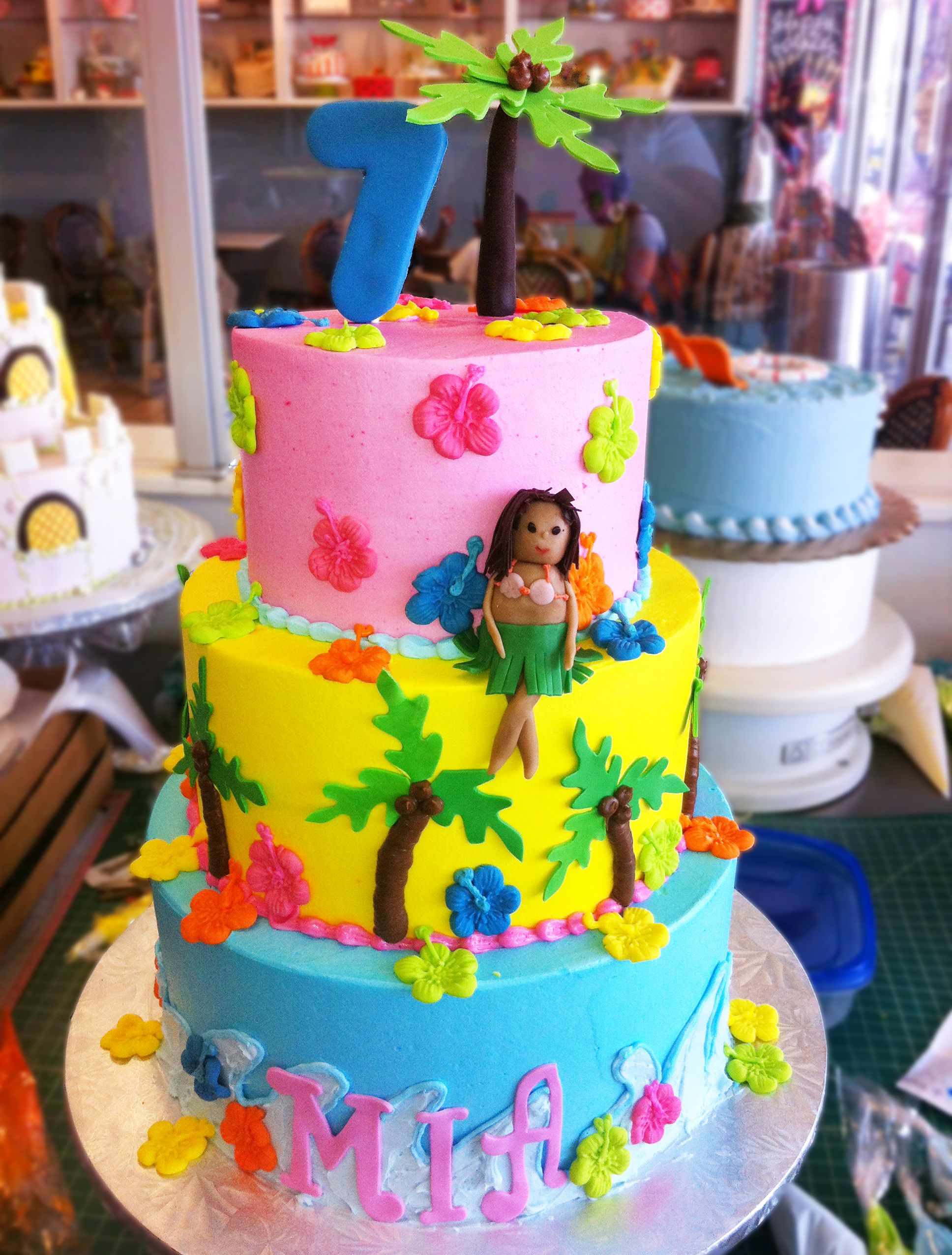 A Hawaiian hula cake for a seventh birthday party! Perfect for a beach or pool party. Cake # 110.