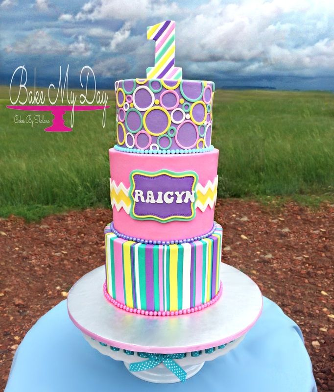 Modern first birthday cake Iced in buttercream with fondant
