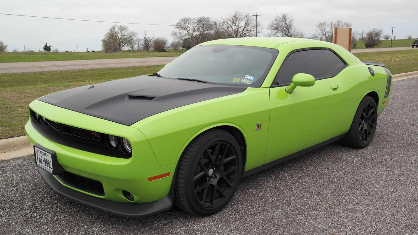 This 2015 lime green dodge challenger received a classic mopar makeover car wrap city installed