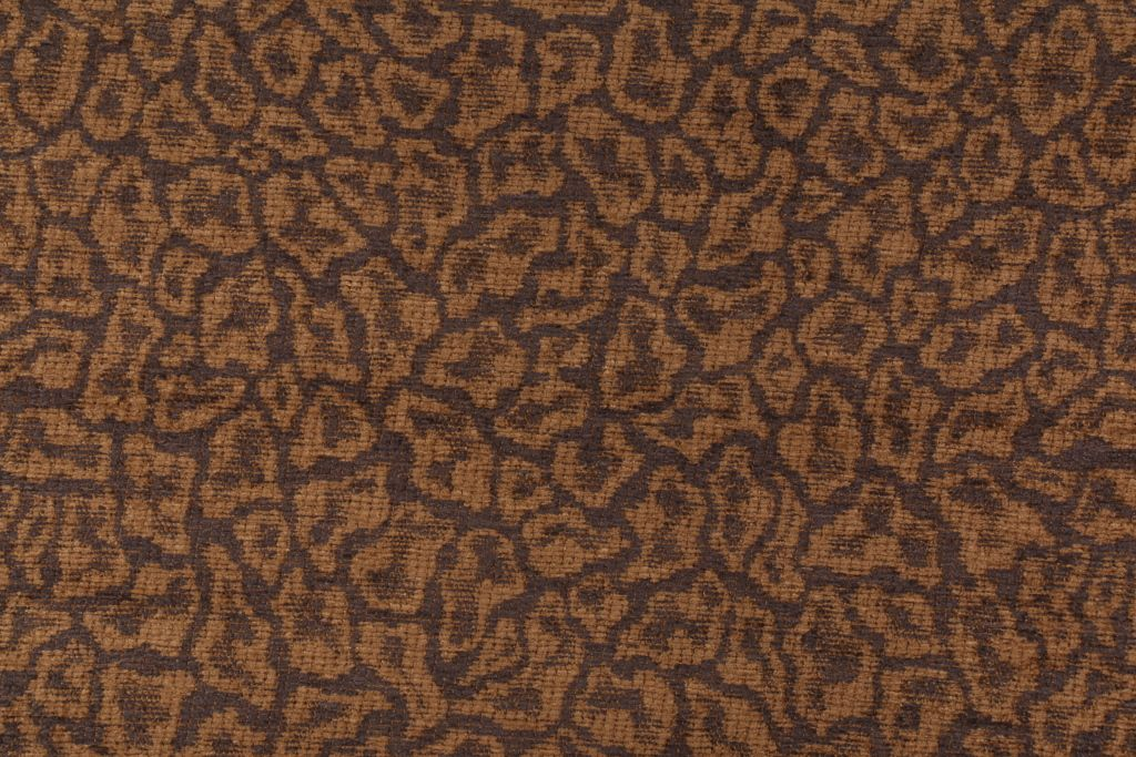 I bought two yards of this leopard fabric to redo two pillows in the living room. Robert Allen Furries Chenille Upholstery Fabric in Charcoal $9.95 per yard